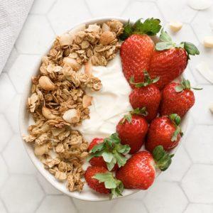 Macadamia and Coconut Granola bowl with yoghurt and strawberries